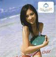 Close up on the cover of the Vmac pamphlet showing a girl playing in the ocean