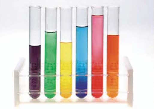 Test tubes with brightly coloured liquid in them (purple, green, yellow, blue, pink and orange)