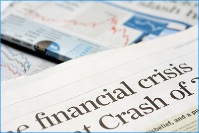 "A pile of news papers with the headline "" financial crisis….crash of…"""