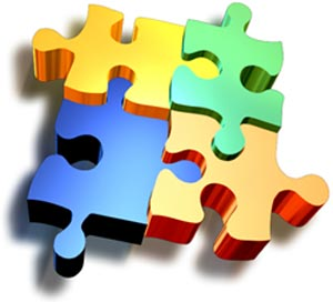 Four colourful  puzzle pieces blue, yellow green and orange