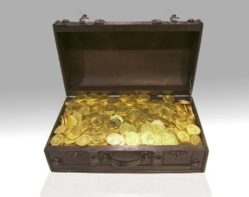 A dark wood, wooden chest full of gold coins