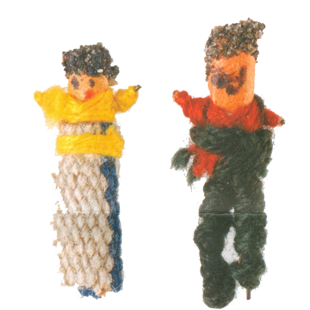 A male and female worry doll