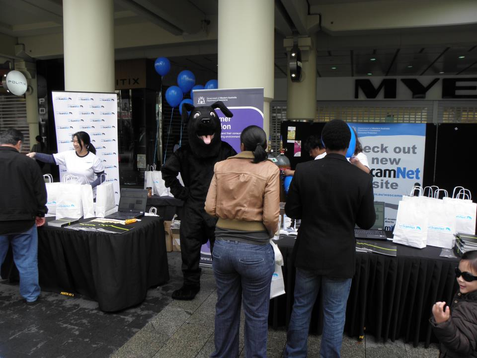 A shot of the booth at the ScamNet launch showing Jet greeting the public