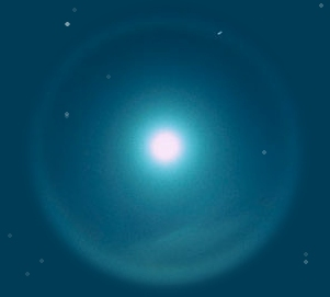 A photograph of the moon with a ring of white light around it set in a blue night sky