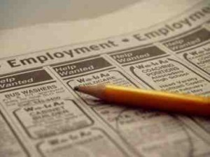 An employment add circled in a newspaper