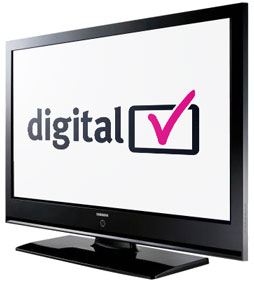 A flat screen TV monitor with digital TV and a pink tick written on it