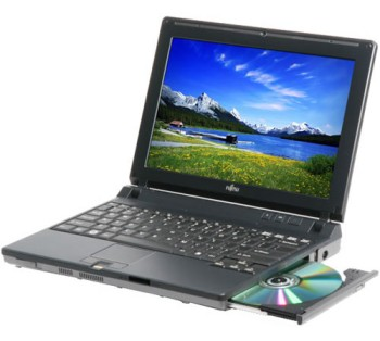 A laptop computer with an open CD drive (with a CD in it); the screen has an image of a mountain scene.